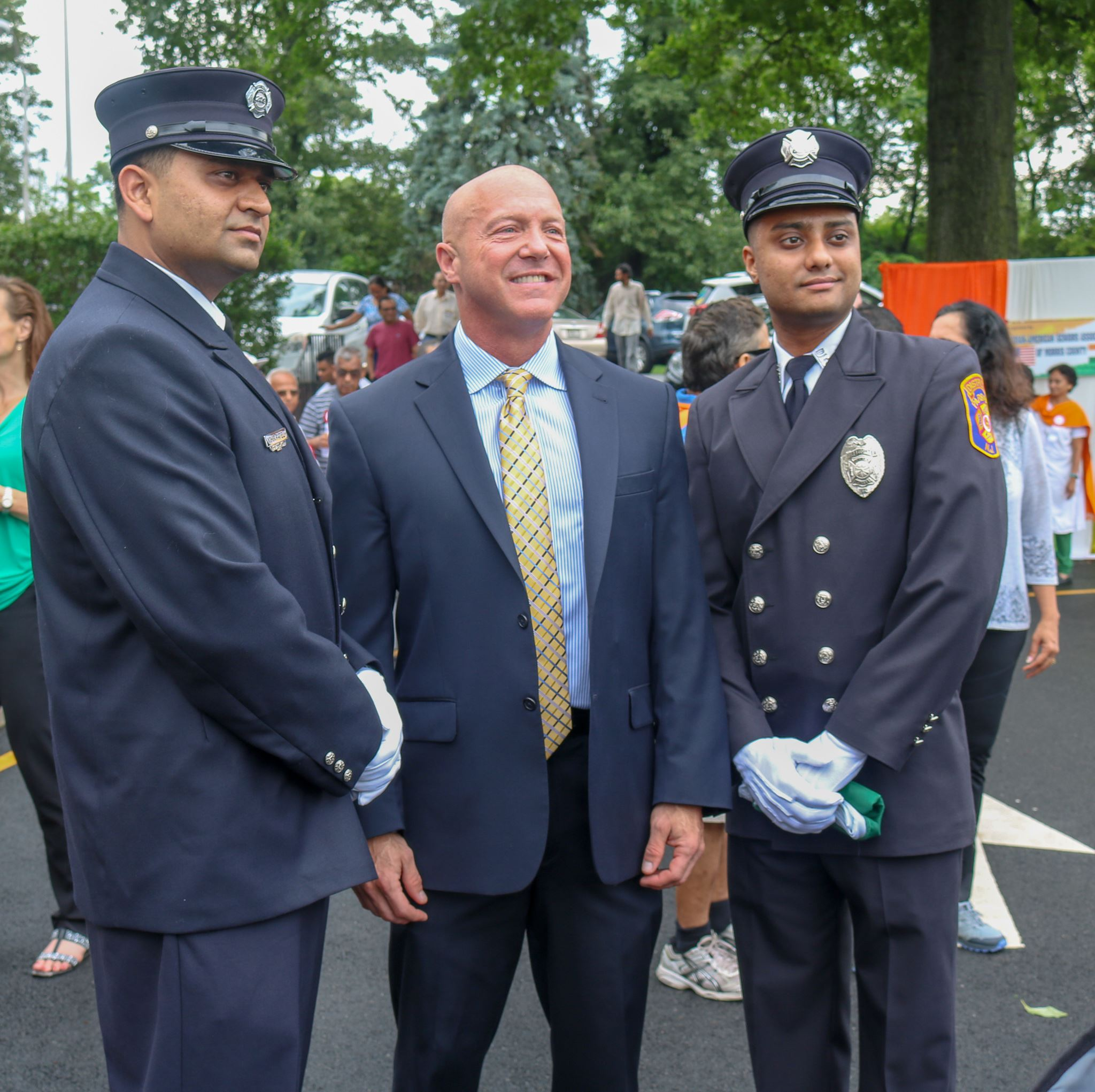 Council President Carifi and two Volunteer Firemen